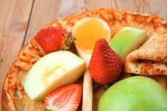 Baked food : pancake with honey Royalty Free Stock Image