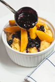 Baked French toast with peaches and blueberries Stock Photos