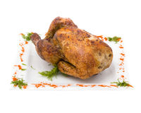 Baked fried chicken carcass isolated on white Royalty Free Stock Photo