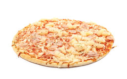 Baked frozen pizza isolated. Baked frozen pizza with cheese, ham and pineapples isolated over the white background Stock Image
