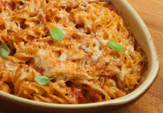 Baked Fusilli Pasta au Gratin. Baked fusilli pasta with chicken sauce and Parmesan cheese Royalty Free Stock Images