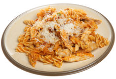 Baked Fusilli Pasta with Chicken. Fusilli pasta with chicken, sauce & Parmesan cheese Royalty Free Stock Photography