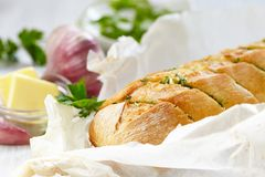 Baked garlic bread with herbs Stock Photos