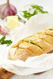 Baked garlic bread with herbs Stock Photo