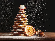 Baked gingerbread christmas tree on wooden background Stock Photos
