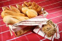 Baked goods. In the basket on red tablecloth Royalty Free Stock Image