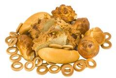 Baked goods. Many golden baked goods on white stock image