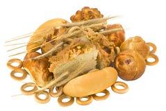 Baked goods. Many golden baked goods on white stock photo