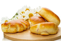 Baked goods and daisies Stock Photos