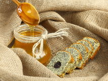 Baked Goods with Poppy and Honey. Fresh Homemade baked goods with poppy seed and next to a jag of honey Stock Images