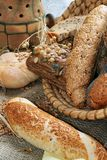 Baked goods still life. Detail of various breads and wheat Stock Image