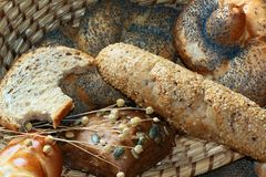 Baked goods still life. Detail of various breads and wheat Stock Photos