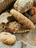 Baked goods still life. Detail of various breads and wheat Royalty Free Stock Photography