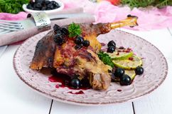 Baked Goose Leg In Berry Sauce On A Ceramic Plate Stock Photography