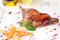 Baked goose leg Stock Image
