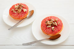 Baked grapefruit with walnuts Stock Image