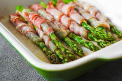 Baked green asparagus wrapped with bacon Stock Photos