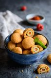 Baked olives in cheese and paprika dough Royalty Free Stock Photo