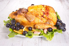 Baked guinea fowl. With fruit royalty free stock image