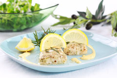Baked hake. With olive oil and rosemary Royalty Free Stock Image
