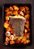 Baked halibut fish with vegetables Stock Images