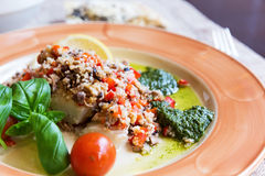 Baked halibut with vegetable garnish Stock Photo