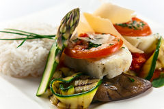 Baked halibut with vegetables Royalty Free Stock Image