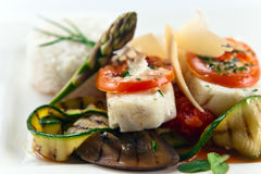 Baked halibut with vegetables Royalty Free Stock Photography