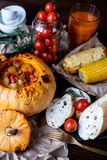 Baked Halloween pumpkin. With vegetables Stock Photo