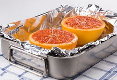 Baked halves grapefruit royalty free stock images