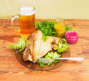 Baked ham hock, condiments and lager beer Stock Photography