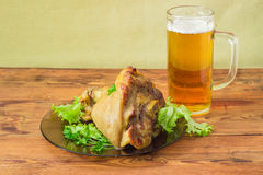 Baked ham hock on glass dish and lager beer Stock Image