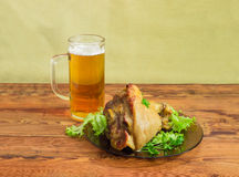 Baked ham hock on glass dish and lager beer Royalty Free Stock Image