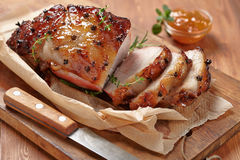 Baked ham with orange fruit jam. Baked meat with orange fruit jam and allspice Royalty Free Stock Image