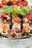 Baked ham rolls. Filled with chicken meat and black olives Royalty Free Stock Image