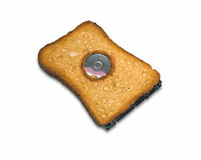 Baked hard disk. All digital theme composition between bread and hard disk Royalty Free Stock Images