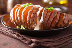 Baked hasselback potato with sour cream Stock Images