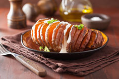 Baked hasselback potato with sour cream Royalty Free Stock Photography
