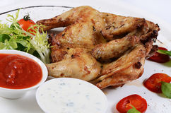 The baked hen with salad close-up Stock Photography