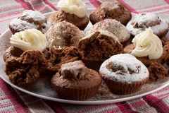 Baked homemade muffins. Cakes baked in the oven, on a plate Royalty Free Stock Photos