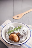 Baked jacket potato in aluminium foil Royalty Free Stock Image