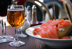 Baked jacket potato with salmon and glass of cider Stock Images