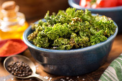 Baked Kale Chips. A bowl of crispy delicious baked kale chips Royalty Free Stock Image