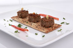 Baked Kibbe on a bran cracker Stock Images
