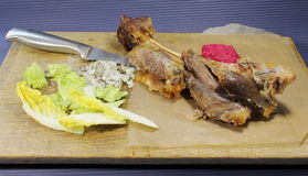 Baked lamb leg Royalty Free Stock Photo
