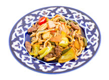 Baked lamb with noodles and stewed vegetables. Royalty Free Stock Photo
