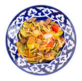 Baked lamb with noodles and stewed vegetables. Royalty Free Stock Images