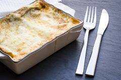Baked lasagna in ceramic casserole dish Stock Images
