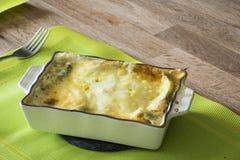 Baked lasagna in ceramic casserole dish Stock Image