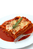 Baked lasagna with garnish Stock Photo
